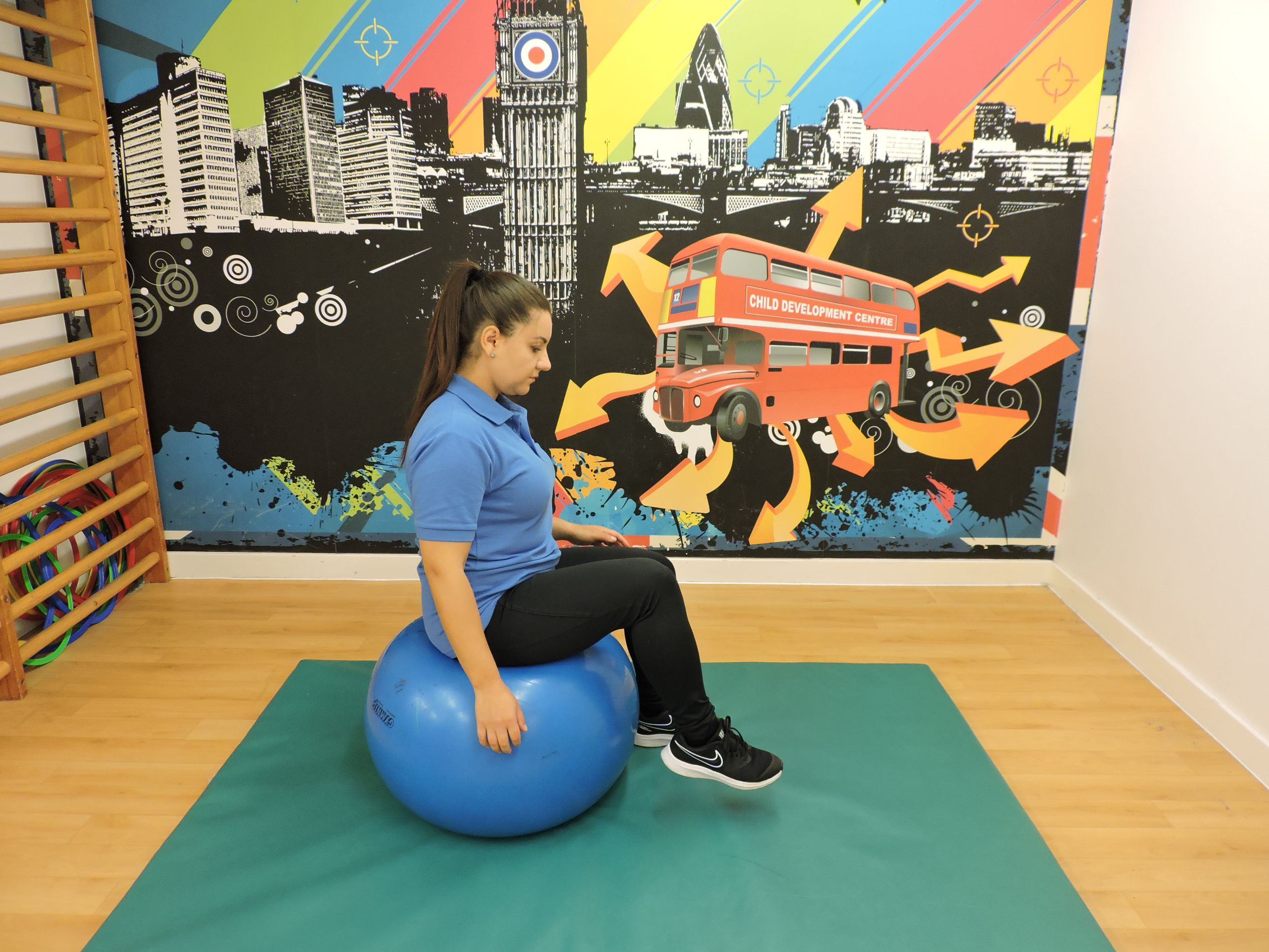 Knee raises whilst sitting on a gym ball.JPG